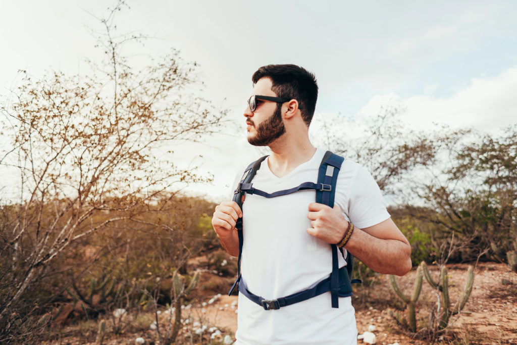 Young backpacker hiking