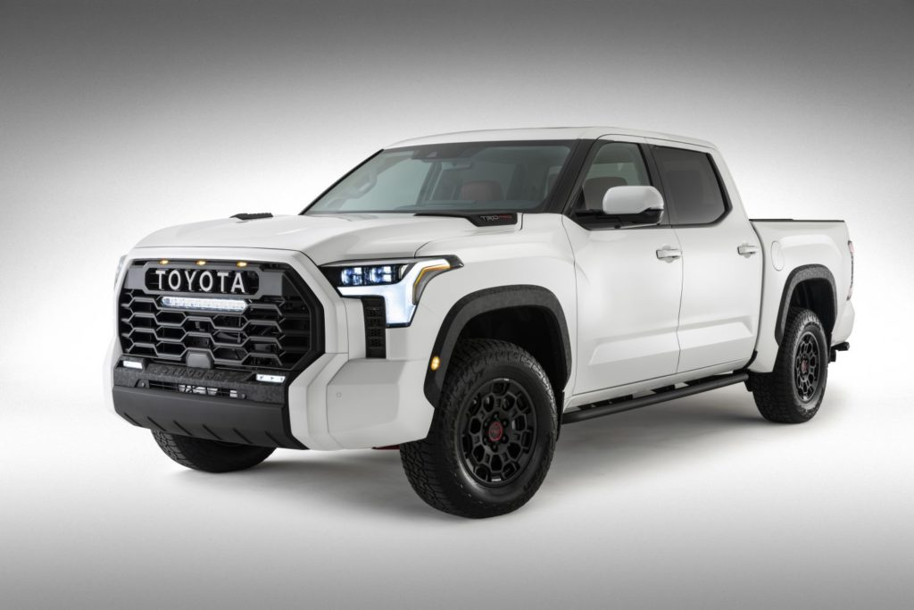 A white 2022 Toyota Tundra against a white and gray background. The full truck is in view.